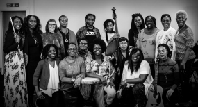 Millicent Stephenson Cafemnee Group shot bw BBC1 Songs Of Praise